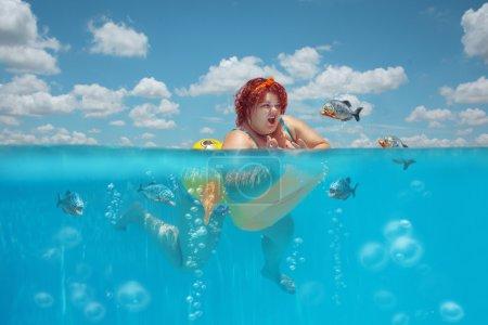 Fatty woman and piranhas