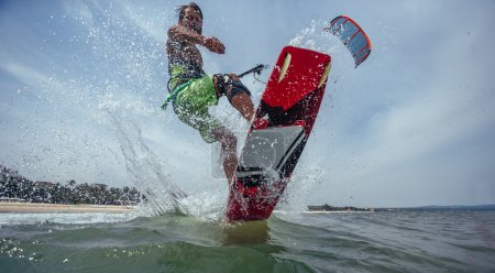 Photo for Kite Surfer Riding Wave. Extreme Sport - Royalty Free Image