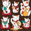 Seamless vector pattern with lucky cats, lucky cha...