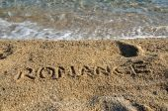 Slovo Romance na pláži