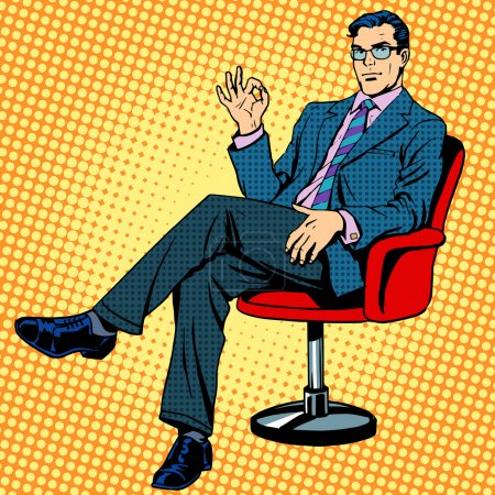 Businessman sitting in an armchair gesture okay