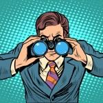 Businessman looking through binoculars. Lead visio...