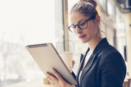 Photo for Portrait of a businesswoman using a digital tablet - Royalty Free Image