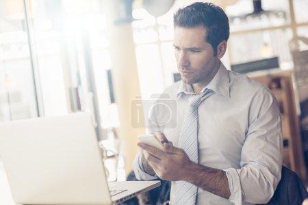 Photo pour Portrait of a businessman having coffee break - image libre de droit