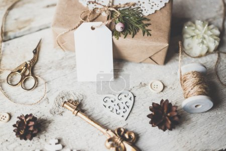 Photo for Cozy vintage toned winter holidays Christmas Composition with Gifts Boxes and Balls, Pine Cones Wooden Background. Styled photography for blog posts. - Royalty Free Image