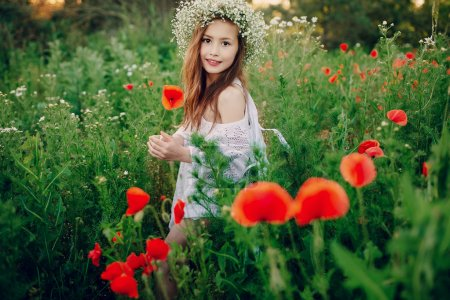 Photo for Beautiful little girl in a wreath of poppies - Royalty Free Image