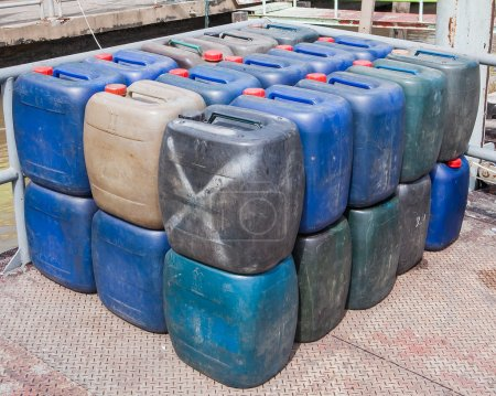 Plastic canisters for machine oil on ground