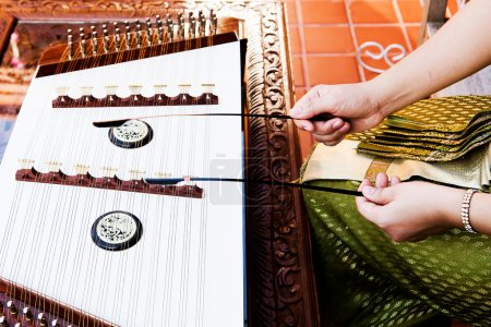 hand play dulcimer, music instrument,Thai wooden dulcimer musica