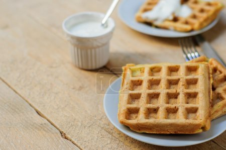 Zuccini hash brown waffles with sour cream