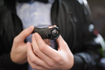 Closeup of a mini video camera held in hand