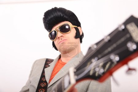 Poster: Elvis Presley plays guitar