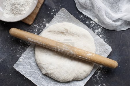 Roll out dough on table