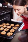 Young woman cooking cookies