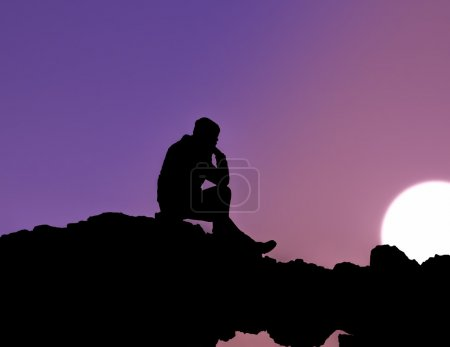 Photo for Silhouette of man sitting at sunset - Royalty Free Image
