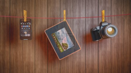 Photo for Different electronics devices on a rope - Royalty Free Image