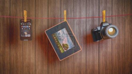 Photo pour Différents appareils électroniques sur une corde - image libre de droit