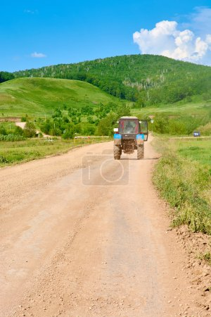 Tractor driving on country road