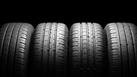 Photo for Four car summer tires in dramatic lighting - Royalty Free Image