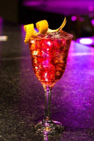 Sangria in glas - orange, lemon in dark bar background