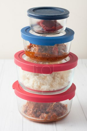 Photo for Isolated close up of stack of glass containers with leftovers - Royalty Free Image