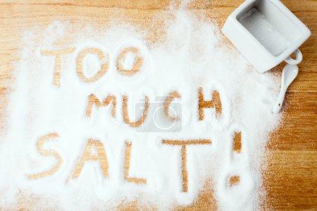 words TOO MUCH SALT handwritten on salt