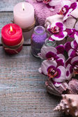 Spa setting  therapy with flowers orchids isolated on a wooden background. Selective focus