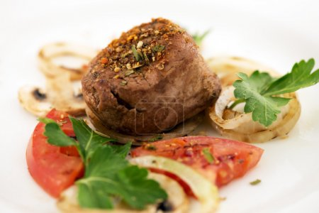 Beef Steak grilled with vegetables on a white plate