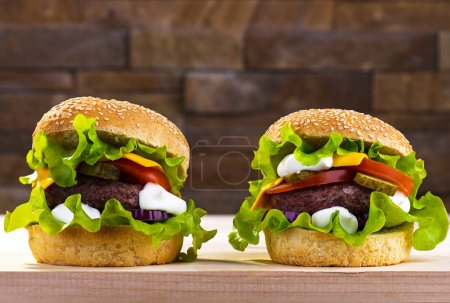 Photo for Big burger with beef cutlet and fresh vegetables - Royalty Free Image