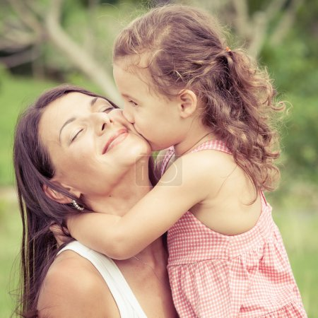 Photo pour Happy mother and daughter playing in the park at the day time. Concept of celebration Mothers day . - image libre de droit