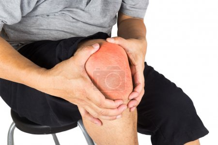 Close up on the painful knee joint of a matured man