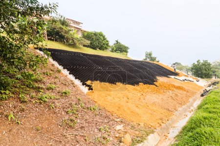 Slope erosion control with grids and earth on stee...