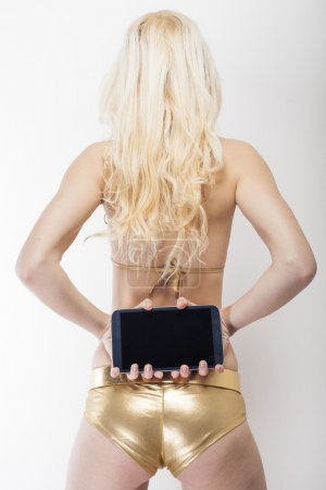Sexy blond holds tablet pc capture from behind