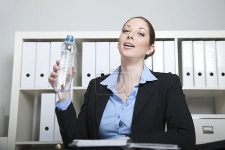 Businesswoman with water bottle