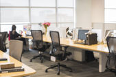 Office blur background with wooden desk and modern chair