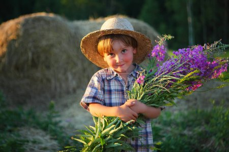 The life of a little boy in nature in the villagev...
