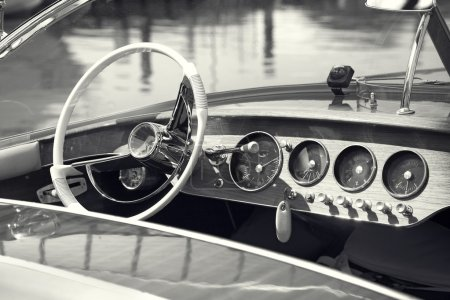 Vintage luxury boat commands