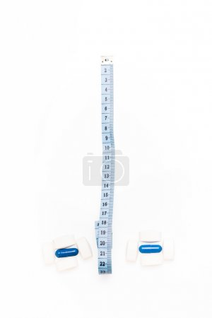 Medical pills and centimeter, for weight loss or increase penis size