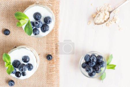 Blueberry yogurt in a glass. Healthy breakfast. Cl...