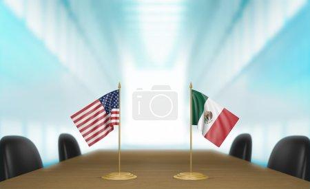 Photo pour Drapeaux miniatures de table pour les États-Unis et le Mexique à une table de réunion pour les discussions diplomatiques et les négociations. - image libre de droit