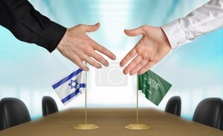 Photo pour Two diplomats from Israel and Saudi Arabia extending their hands for a handshake on an agreement between the countries. - image libre de droit