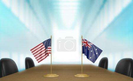 Photo pour Drapeaux de table miniature pour les États-Unis et l'Australie à une table de réunion pour les négociations et discussions diplomatiques. - image libre de droit