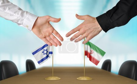 Photo pour Two diplomats from Israel and Iran extending their hands for a handshake on an agreement between the countries. - image libre de droit