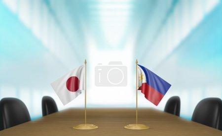 Photo pour Drapeaux miniatures de table pour le Japon et les Philippines à une table de réunion pour des discussions et des négociations diplomatiques. - image libre de droit