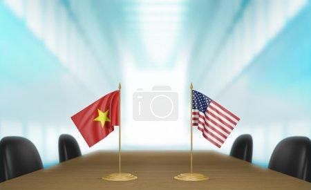 Photo pour Drapeaux de table miniature pour le Vietnam et les Etats-Unis à une table de réunion pour les négociations et discussions diplomatiques. - image libre de droit