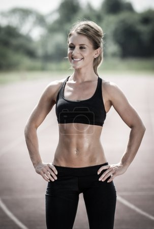 Happy young woman with slim and toned body