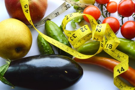 Vegetables and fruits for weight loss with a measuring tape