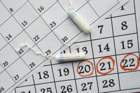 Menstruation calendar with sanitary tampons