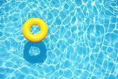 Yellow pool floats in a swimming pool