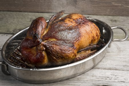 Whole roasted duck with spices and syrup glazed (l...