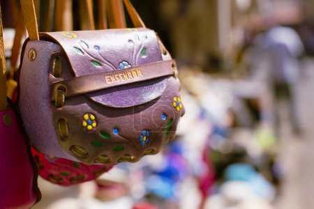 Pink and purple lather purses in the flea markets ...